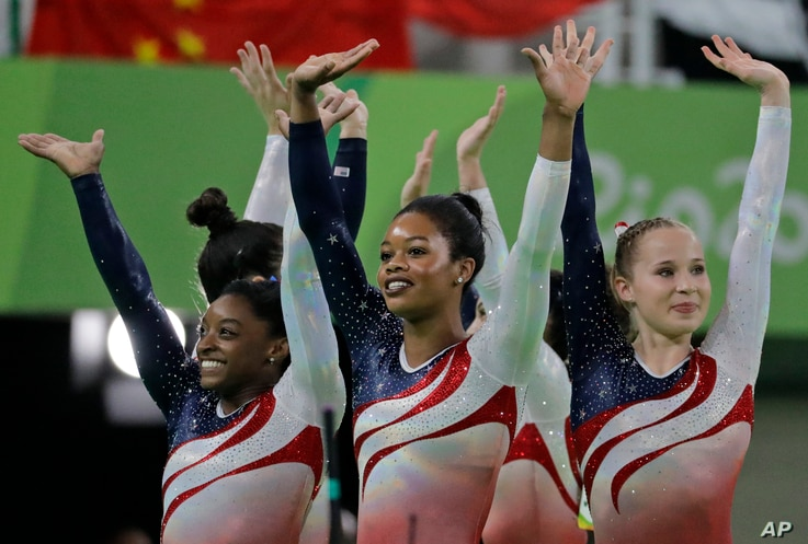 U.S. gymnasts, left to right, Simone Biles, Gabrielle Douglas and Madison Kocian wave to the audience at the end of the artistic gymnastics women's team final at the 2016 Summer Olympics in Rio de Janeiro, Brazil, Aug. 9, 2016.