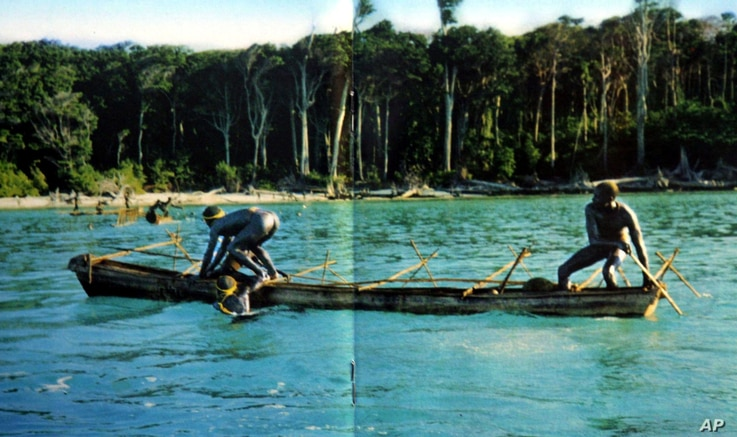 In this undated photo released by the Anthropological Survey of India, Sentinelese tribe men row their canoe in India's Andaman and Nicobar archipelago.