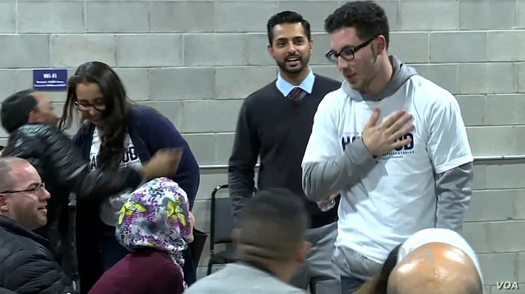 Abdullah Hammoud, (in white) an Arab-American Muslim, greets supporters after winning a seat in the Michigan House of Representatives, November 8, 2016.