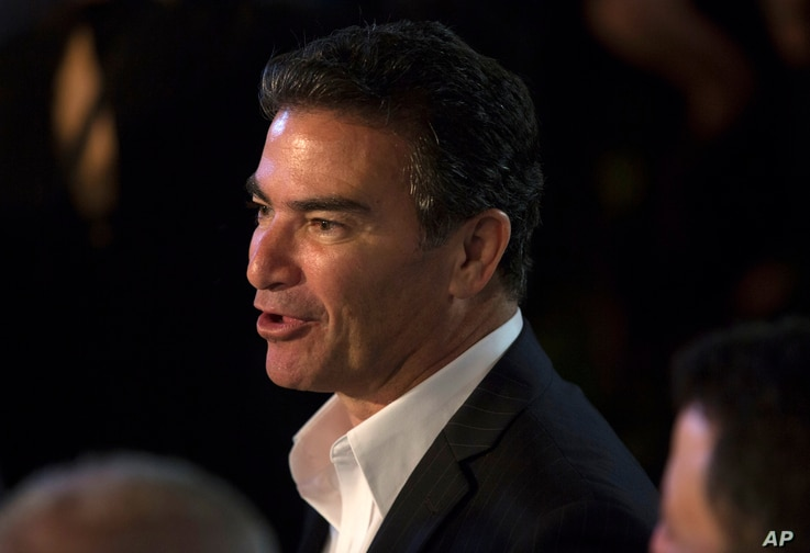 In this July 3, 2017 photo, Yossi Cohen, the head of the Israeli Mossad attends U.S. Independence Day celebrations at the residence of Ambassador to Israel, David Friedman.