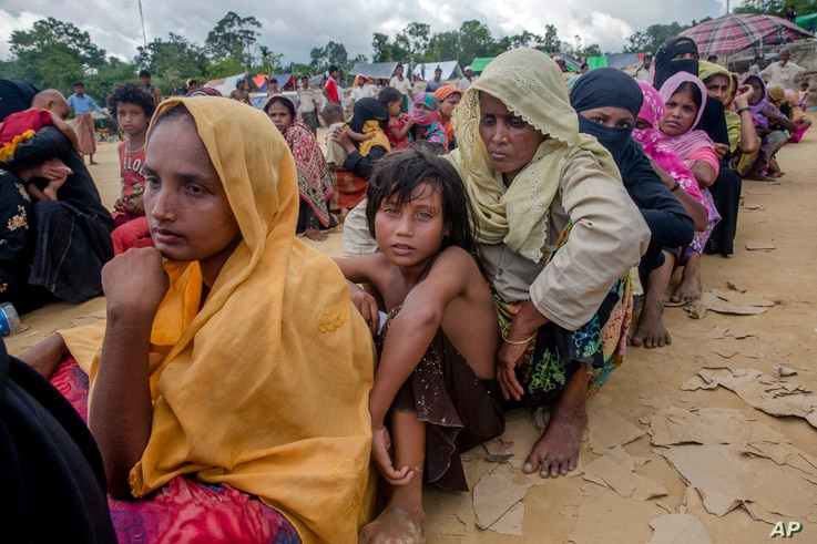 Rohingya Muslims, who recently crossed over from Myanmar into Bangladesh, wait for their turn to receive food aid near Balukhali refugee camp, Bangladesh, Friday, Sept. 15, 2017. Thousands of Rohingya are continuing to stream across the border, with
