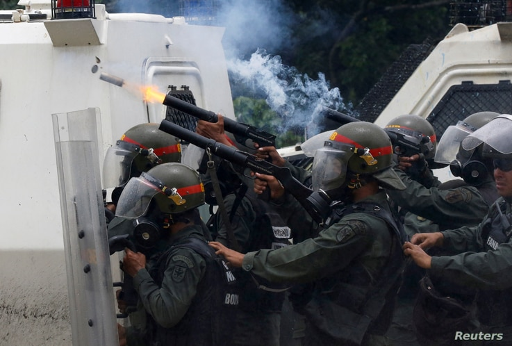 Riot police fire tear gas while clashing with opposition supporters rallying against President Nicolas Maduro in Caracas, Venezuela May 3, 2017.
