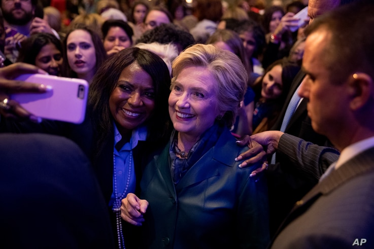 Democratic presidential candidate Hillary Clinton takes a photograph with a member of the audience after speaking at a Women for Hillary fundraiser at the Hyatt Regency in Washington, Oct. 5, 2016. Clinton's campiagn is now actively mobilizing the wo