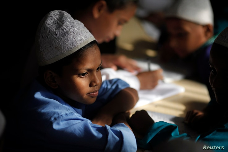 A students reads the Koran in a Madrasa during the holy month of Ramadan in Old Dhaka July 1, 2014. Muslims are observing the fasting month of Ramadan, Islam's holiest month, during which observant believers fast from dawn to dusk. They celebrate the...