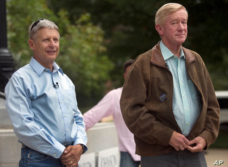 FILE - Former New Mexico Gov. Gary Johnson, left, stands with his vice presidential running mate, former Massachusetts Gov. William Weld, during a campaign rally, Aug. 25, 2016, in Concord, N.H.