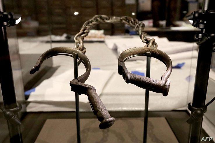 A pair of slave shackles are on display in the Slavery and Freedom Gallery in the Smithsonian's National Museum of African American History and Culture during the press preview on the National Mall Sept. 14, 2016 in Washington, DC.
