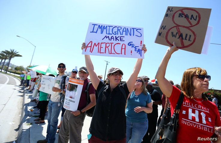 Immigrant rights advocates protest near the U.S.-Mexico border over a visit by U.S. Attorney General Jeff Sessions and Secretary of Homeland Security John Kelly in San Ysidro, a district of San Diego, California, April 21, 2017.