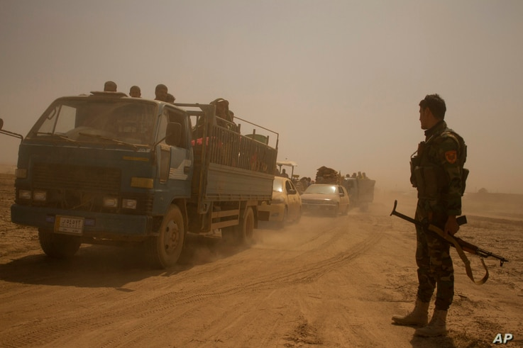 Hundreds of civilians flee villages outside Mosul a day after Iraqi Kurdish forces launched an operation east of Islamic State-held Mosul, Aug. 15, 2016.