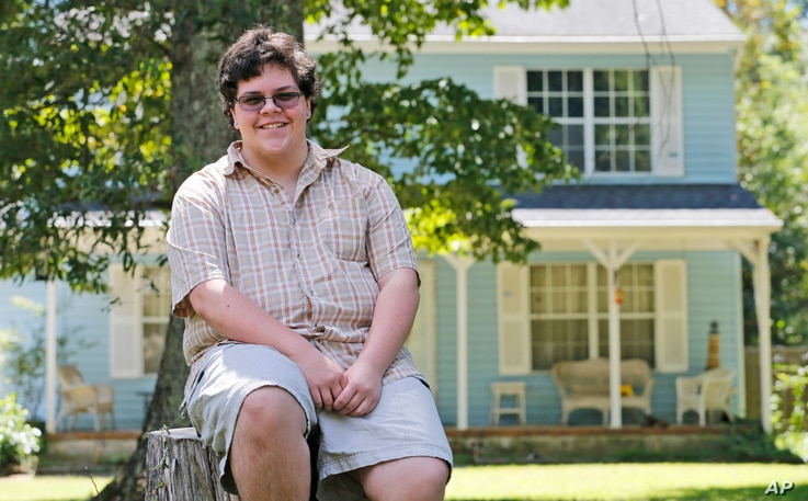FILE - Transgender high school student Gavin Grimm poses in front of his home in Gloucester, Va., Aug. 22, 2016. The Supreme Court will take up transgender rights for the first time in the case of a Virginia school board that wants to prevent Grimm, ...