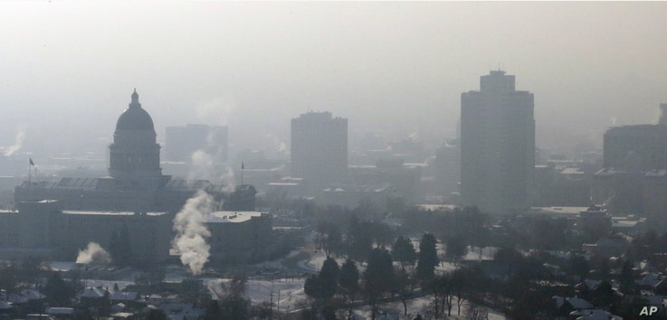 FILE - Haze from an inversion hangs over downtown Salt Lake City, Jan. 7, 2013.