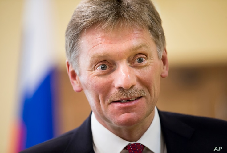 FILE - President Vladimir Putin's spokesman Dmitry Peskov speaks to The Associated Press in Moscow.