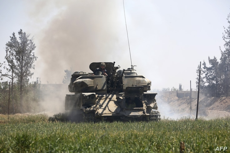 Pro-Syrian regime forces advance toward the town of Douma, the last opposition holdout in eastern Ghouta, April 7, 2018, after regime troops resumed a military blitz to pressure rebels to withdraw. Backed by Russia's firepower, Syrian President Basha...