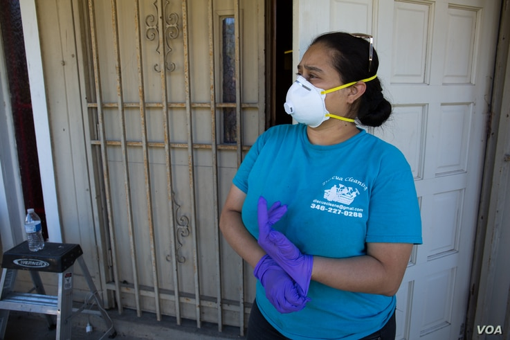 "Elsa Isaula, who runs a small cleaning service in Houston, says inhaling dust from sheetrock becomes inevitable, even when necessary health precautions are taken. ""We feel good because there's a lot of work, but at the same time we feel that itâ€..."