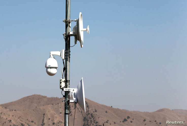Electronic surveillance equipment is seen along the border fence outside the Kitton outpost on the border with Afghanistan in North Waziristan, Pakistan, Oct. 18, 2017.