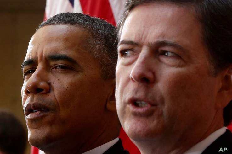 President Barack Obama and FBI Director James Comey participate in the installation ceremony for Comey as FBI director, at FBI Headquarters in Washington, Oct. 28, 2013.