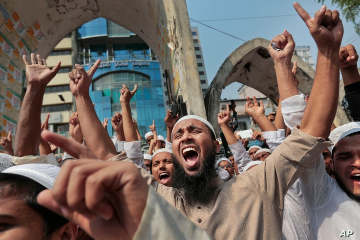 Bangladeshi activists of various Islamic political groups and other Muslims shout slogans after Friday prayers during a protest in Dhaka, Bangladesh, March 25, 2016.