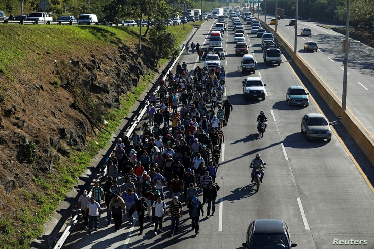 Salvadorans take part in a new caravan of migrants, heading to the United States, as they leave San Salvador, El Salvador, Jan. 16, 2019.