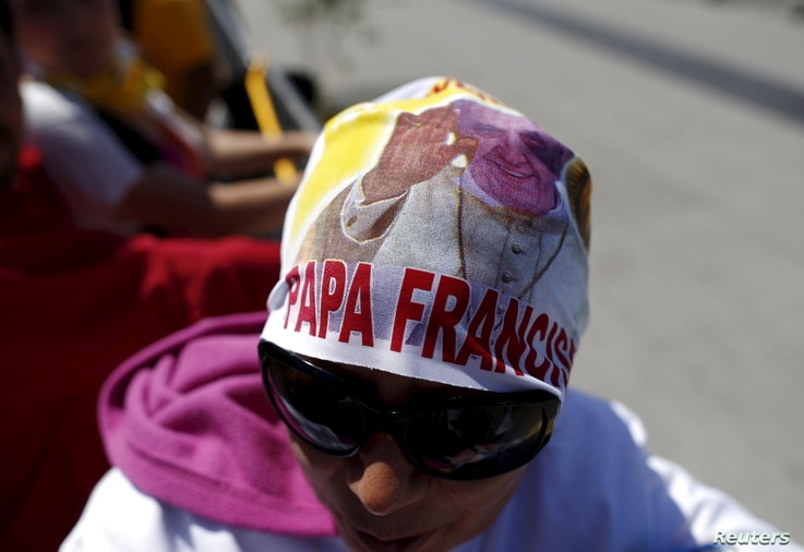 A woman waits for the arrival of Pope Francis at the Guadalupe's Basilica in Mexico City, Feb. 13, 2016.