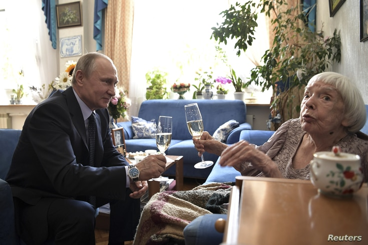 Russia's President Vladimir Putin congratulates head of the Moscow Helsinki Group Lyudmila Alekeyeva on her 90th birthday during a meeting in Moscow, July 20, 2017.