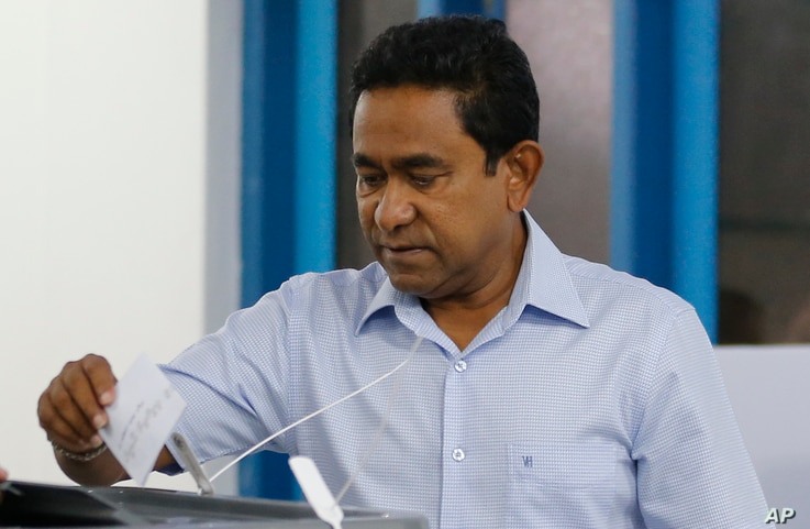 Maldivian president Yameen Abdul Gayoom casts his vote at a polling station during  presidential election day in Male, Sept. 23, 2018.