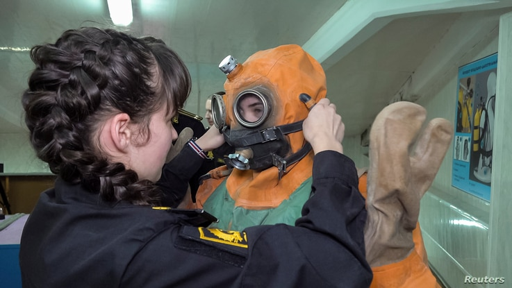 Female naval cadets get ready for a diving training at N. G. Kuznetsov Naval Academy's department in Kaliningrad, Russia in this still image taken from a video shot on March 4, 2019.