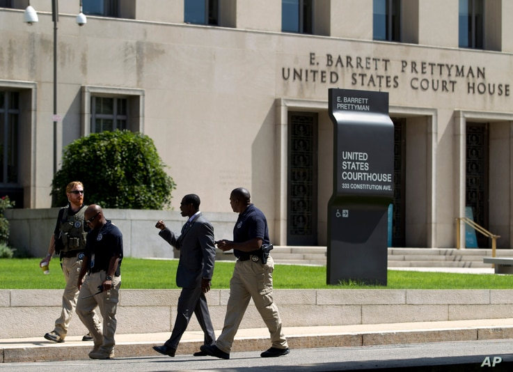 U.S. Marshalls move outside of the federal U.S. District Court in Washington, June 28, 2014