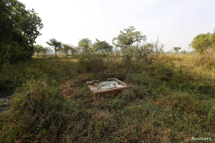 An open toilet is seen in a field in Gorba in the eastern Indian state of Chhattisgarh, India, Nov. 16, 2015.