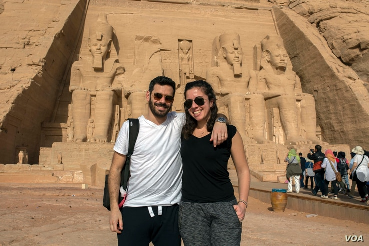 """Egyptian Fady Abadir and his American wife Melis Bursin, who marveled at the experience. """"It's the first time for me here in Egypt,"""" Mursin said. """"It's like a dream for me."""" In Abu Simbel temple in Aswan, southern Egypt, Thursday, Feb. 22, 20..."""