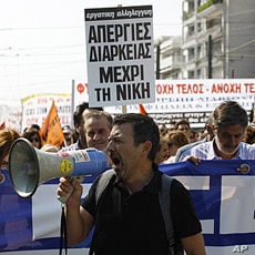 Protesters shout slogans during demonstration in Athens, Greece, October 5, 2011.