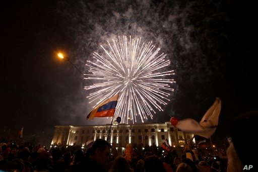 People watch fireworks to mark Russia's formal annexation of Crimea, central Lenin square, Simferopol, Crimea, March 21, 2014.