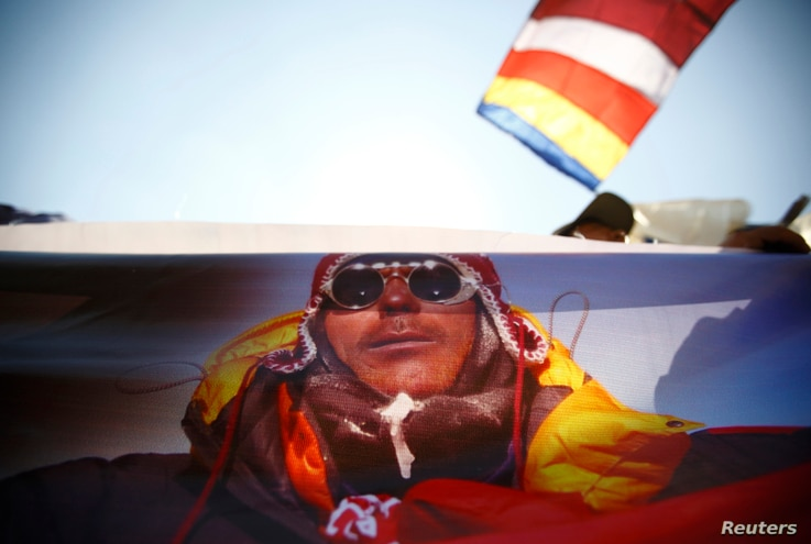 A portrait of Dorjee Khatri, who lost his life in an avalanche at Mount Everest last Friday, is seen on the truck carrying his body during the funeral rally of Nepali Sherpa climbers in Kathmandu, Apr. 21, 2014.