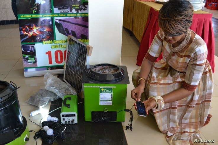 Rose Twine, director of Eco Group Limited, demonstrates a volcanic rock stove in Kampala, Uganda, April 20, 2017.
