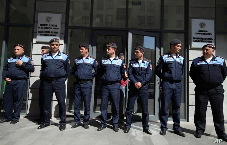Police block the entrance to the Ministry of Justice in Yerevan, Armenia, May 2, 2018.