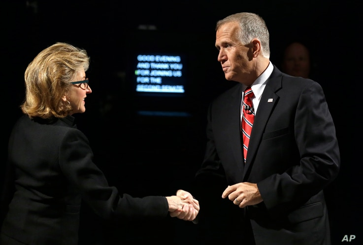 Sen. Kay Hagan,  D-N.C., left, and North Carolina Republican Senate candidate Thom Tillis shake hands prior to an Oct. 7 debate.