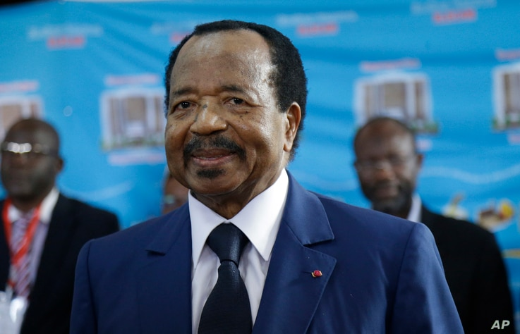 Cameroon's Incumbent President Paul Biya, of the Cameroon People's Democratic Movement party, waits to cast his vote during the Presidential elections in Yaounde, Oct. 7, 2018.