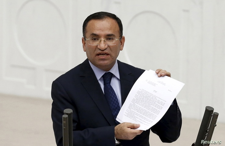 Justice Minister Bekir Bozdag addresses the Turkish Parliament during a debate in Ankara in this March 19, 2014 file photo.