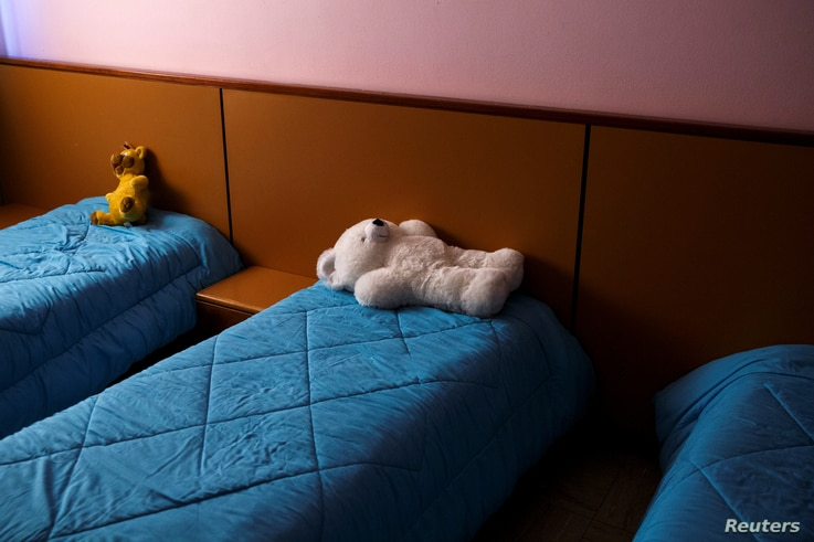 Beds are made to welcome the children for an early afternoon sleep, before leaving for the weekend, at the Model National Nursery of Kallithea, in Athens, Greece, March 3, 2017.