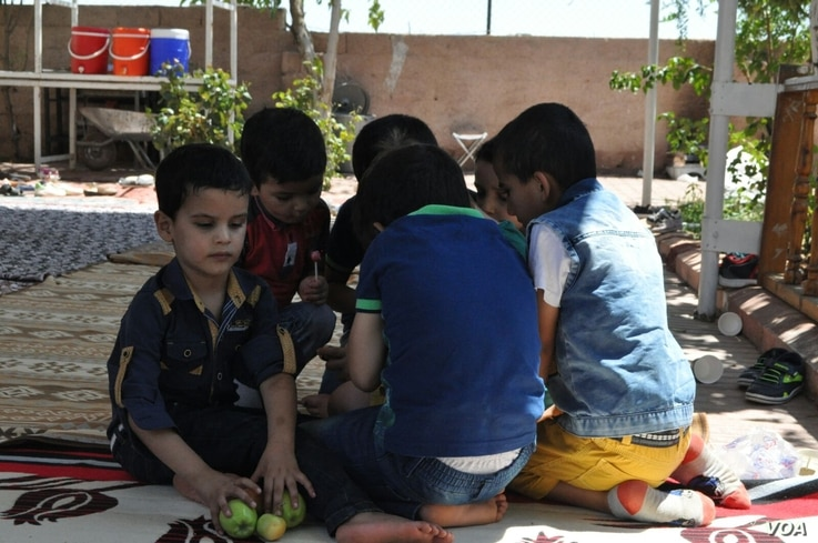 Children eat fruit at the Selam Orphanage. (M. Qarra)