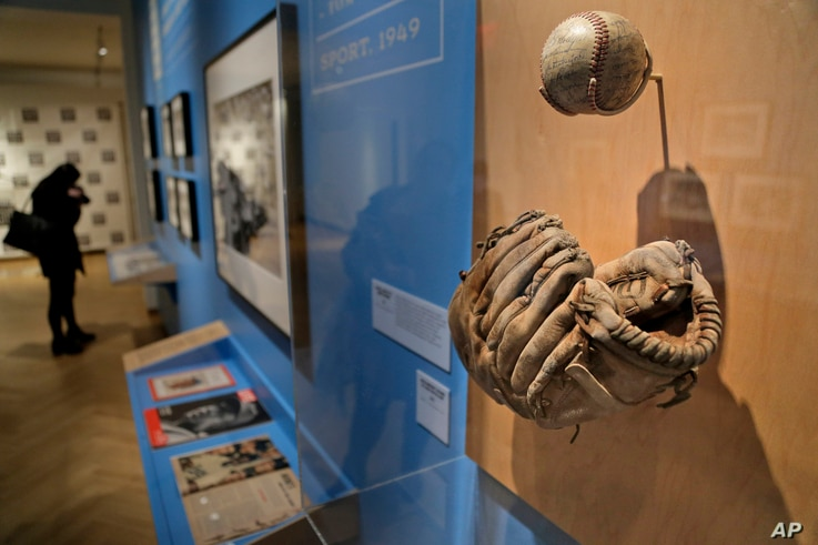 """A glove used by Brooklyn Dodgers baseball player Jackie Robinson is displayed at the exhibit """"In the Dugout with Jackie Robinson: An Intimate Portrait of a Baseball Legend"""" at the Museum of City of New York in New York, Jan. 29, 2019. The 100th anniv..."""