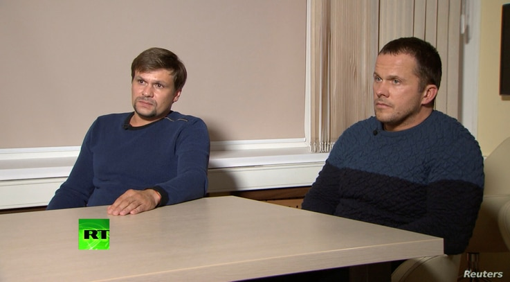 A still image taken from video footage and released by Russia's RT international news channel Sept. 13, 2018, shows two Russian men identified as Alexander Petrov and Ruslan Boshirov during an interview at an unnamed location.