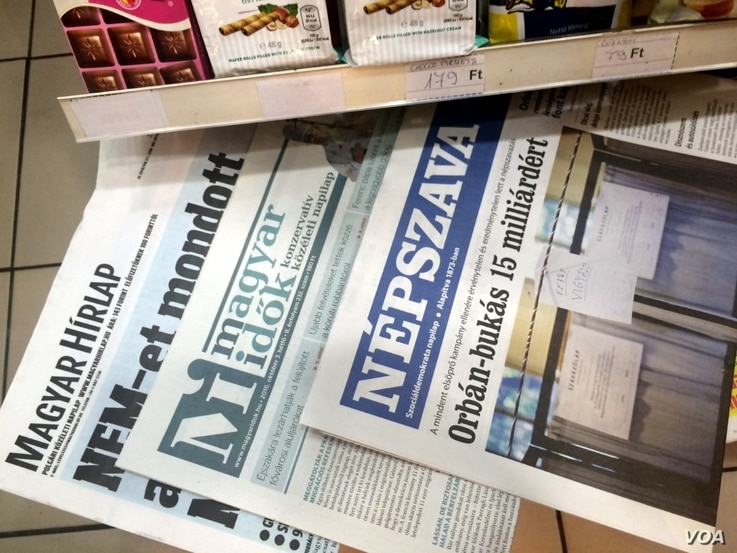 """Newspaper headlines in Budapest declare the referendum against EU-mandated refugee quotas a failure due to low turnout, saying """"The Country Said No"""" and """"The Referendum Failed,"""" despite government declarations of an overwhelming victory, Oct...."""