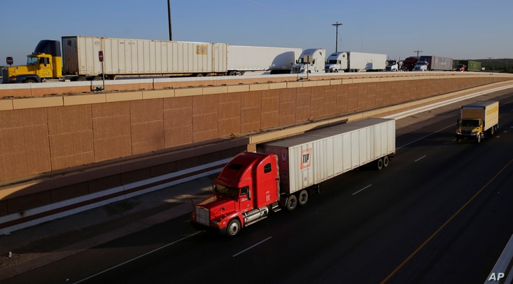 Trucks move along Interstate 35, in Laredo, Texas, Nov. 21, 2016. Donald Trump's campaign promise to abandon the North American Free Trade Agreement helped win over Rust Belt voters who felt left behind by globalization. But the idea is unnerving t...