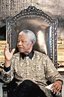 Mandela addressing a meeting, wearing one of Buirski's geometric patterned shirts