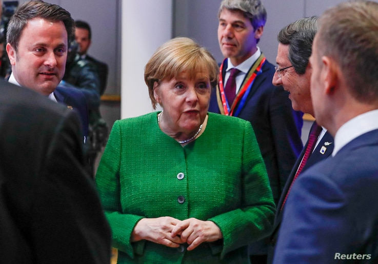 Luxembourg Prime Minister Xavier Bettel, German Chancellor Angela Merkel and European Council President Donald Tusk attend a European Union leaders informal summit in Brussels, Belgium, Feb. 23, 2018.