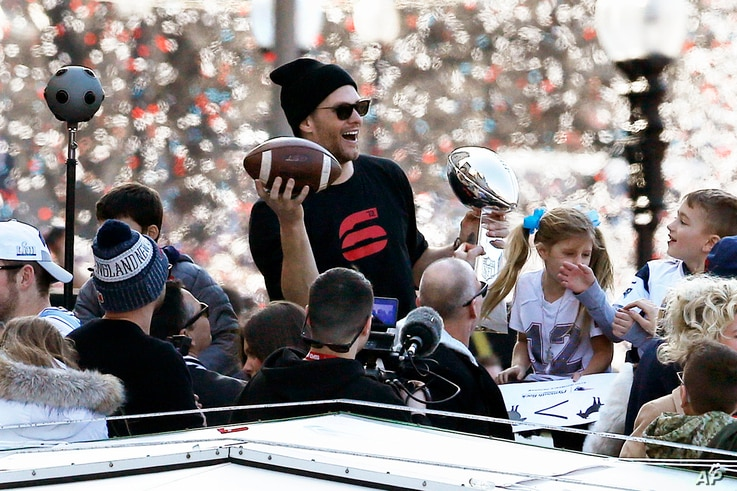 New England Patriots' Tom Brady rides a duck boat during the Patriots parade through downtown Boston, Tuesday, Feb. 5, 2019, to celebrate their win over the Los Angeles Rams in Sunday's NFL Super Bowl 53 football game in Atlanta.