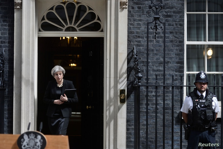 Britain's Prime Minister Theresa May prepares to speak outside 10 Downing Street after an attack on London Bridge and Borough Market left 7 people dead and dozens injured in London, Britain, June 4, 2017.