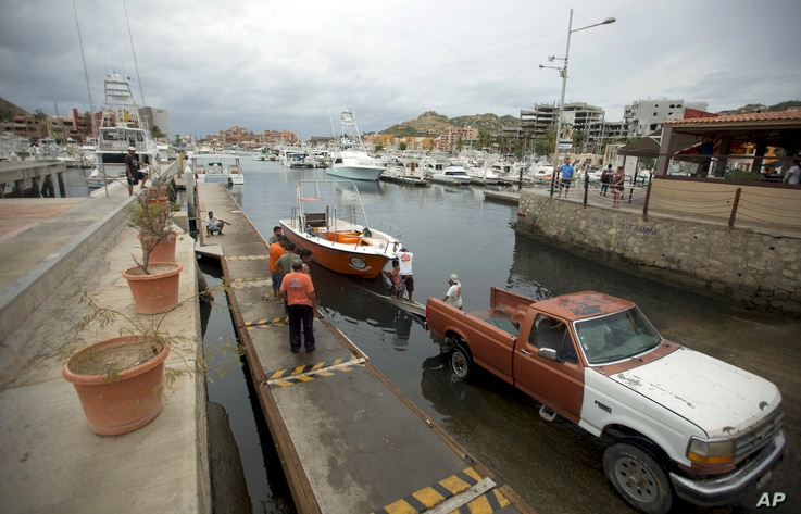 Mexico Tropical Weather Newton: Residents tow a boat out of the water as they prepare for the arrival of Hurricane Newton in Cabo San Lucas, Mexico, Monday Sept. 5, 2016.
