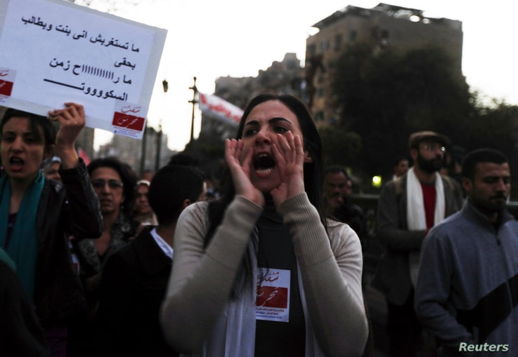 A woman shouts slogans against Egyptian President Mohamed Morsi and members of the Brotherhood during a march against sexual harassment and violence against women in Cairo, Feb. 6, 2013.