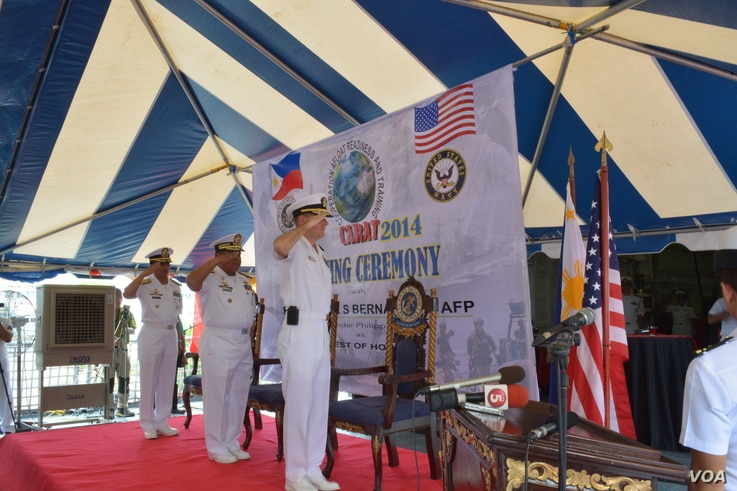 Commodore Ramon Joseph Mercado, Philippines exercises commander, Rear Admiral Jaime Bernardino, Philippine Fleet Commander and Rear Admiral Stuart Munsch, U.S. Commander of Submarine Group 7 stand to attention during opening rites of the joint naval ...