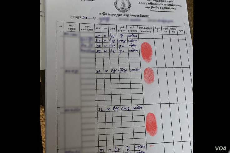 This CPP document from Kampong Chhnang province lists names of registered party members who will be given cash payments three times next year, photo taken Nov. 8, 2017.